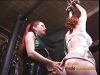 Latex clad redhead wench has her way with a freckled ginger