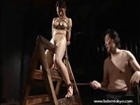 Wooden bondage and tit torture of japanese slave girl