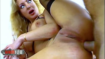Milf with huge boobies is giving an amazing titjob
